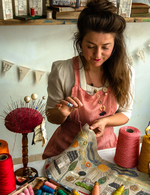 Jessie Chorley stitching in her shop on Columbia Road, London.