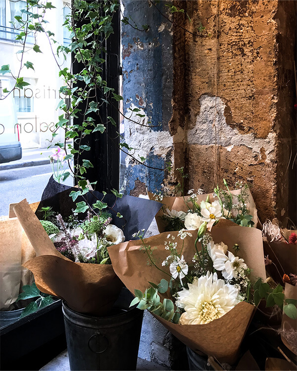 Fresh blooms wrapped in Kraft paper at Fragrance in Paris