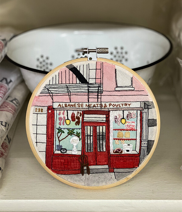An artists embroidery of Albanese Meats & Poultry, Little Italy